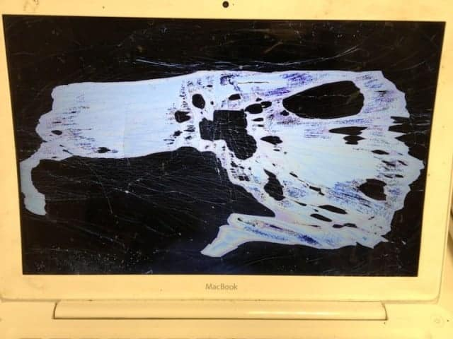A1181 White MacBook with cracked LCD
