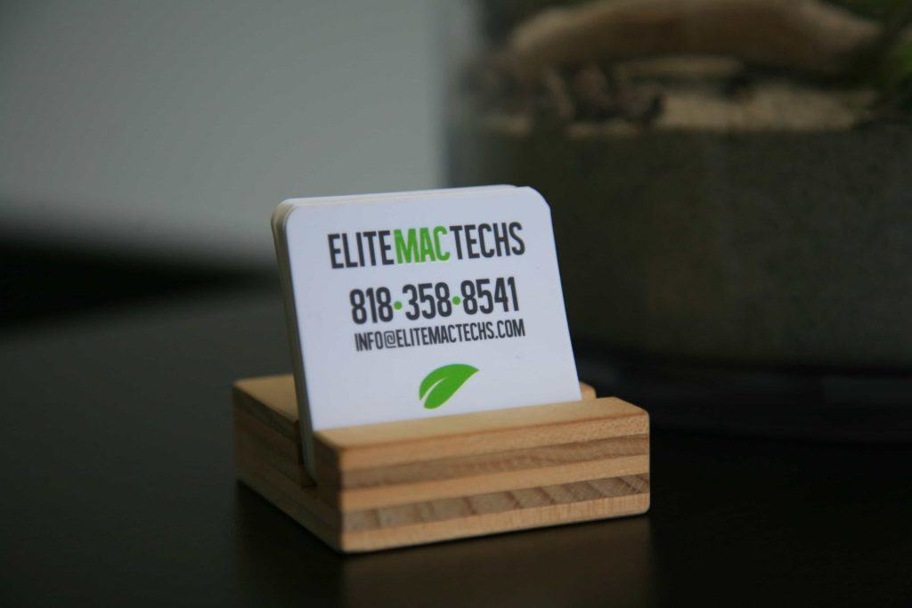 EliteMacTechs business card on table