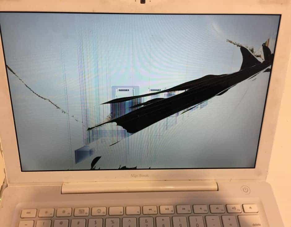 White MacBook With Cracks on screen causing black areas